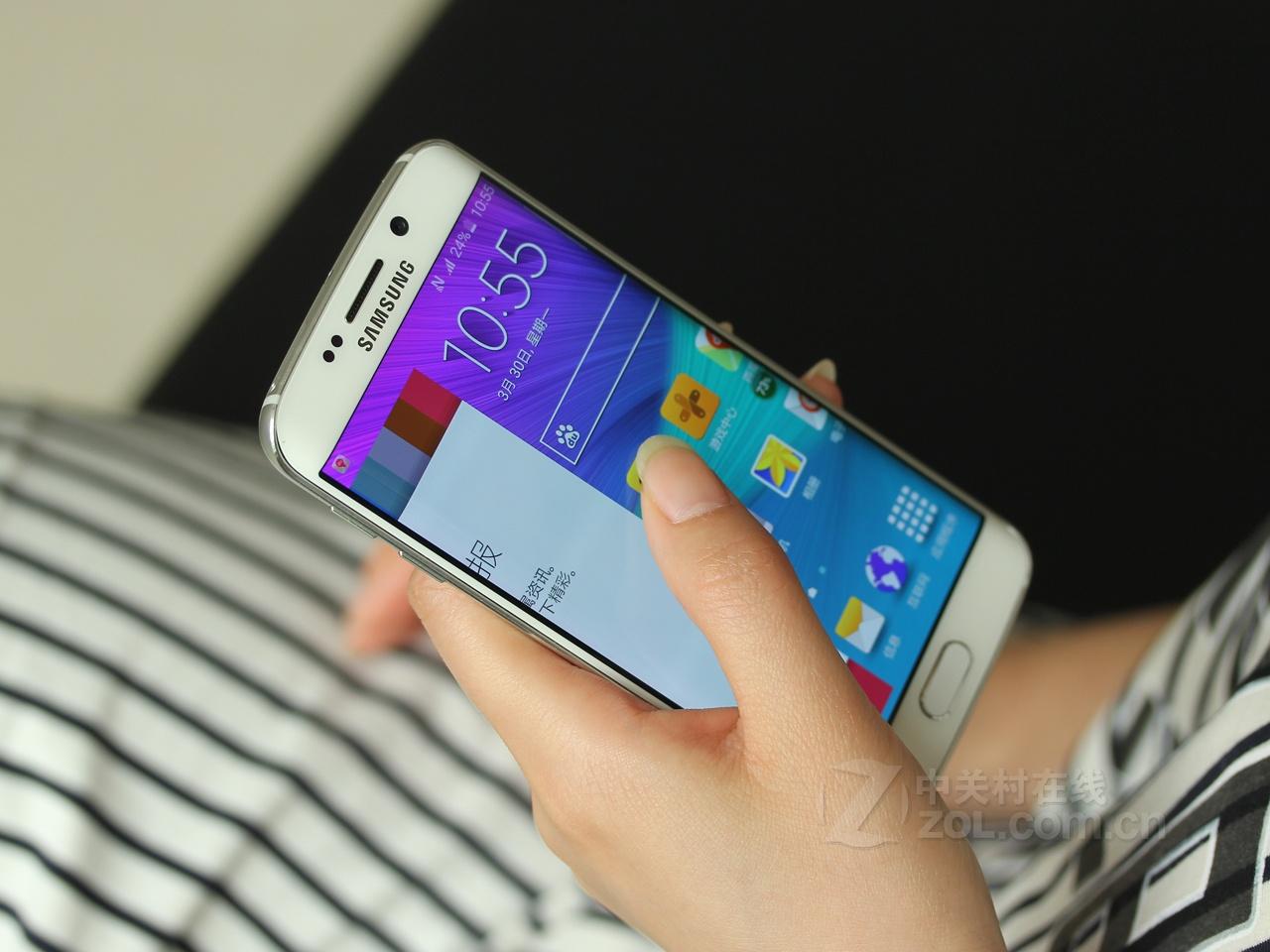 三星S6 Edge 三星正面配备有一块5.1英寸的dual edge Super AMOLED魔焕炫屏,分辨率达到Quad HD级别的25601440像素。核心方面,该机内置主频2.1GHz三星Exynos7420猎户座双四核处理器,采用64位指令集,运行内存3GB RAM,内部存储空间为32GB/64GB/128GB ROM三档,可流畅运行Android5.
